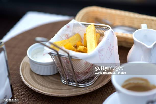 High Angle View Of French Fries And Milk In Jar On Table