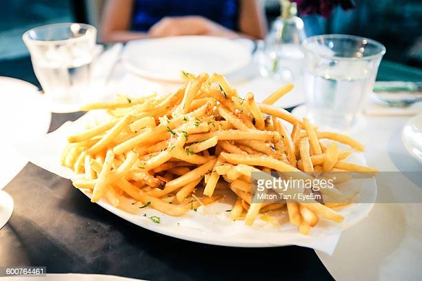 High Angle View Of French Fries In Plate On Table