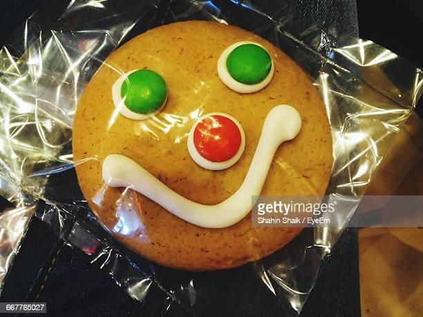 High Angle View Of Fresh Baked Cookie With Anthropomorphic Face In Plastic Packet