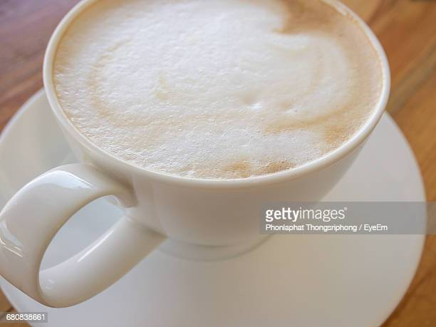 High Angle View Of Fresh Cappuccino On Table