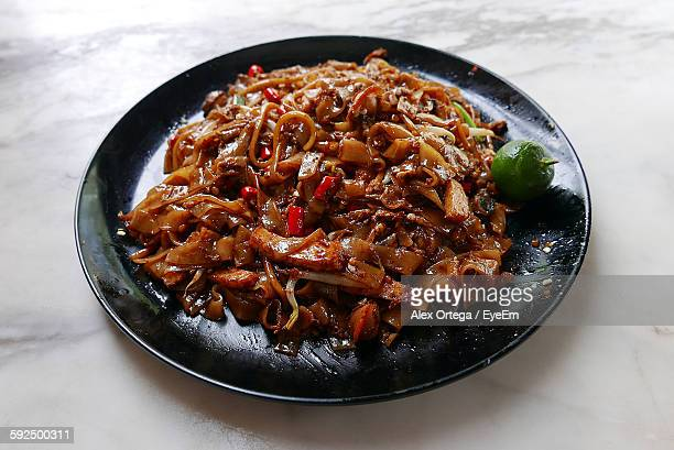 High Angle View Of Fresh Char Kway Teow Served In Plate On Floor