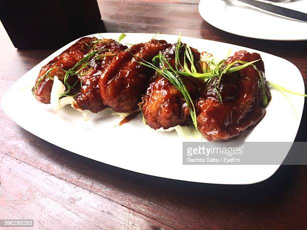 High Angle View Of Fresh Chicken Wings Served In Plate