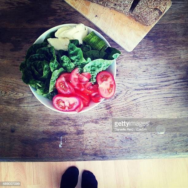 high angle view of fresh chopped vegetables on wooden table - danielle reid stock pictures, royalty-free photos & images