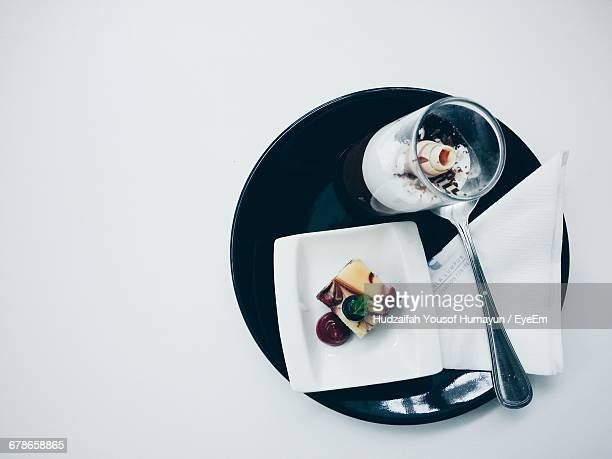 High Angle View Of Fresh Dessert Served In Plate On White Background