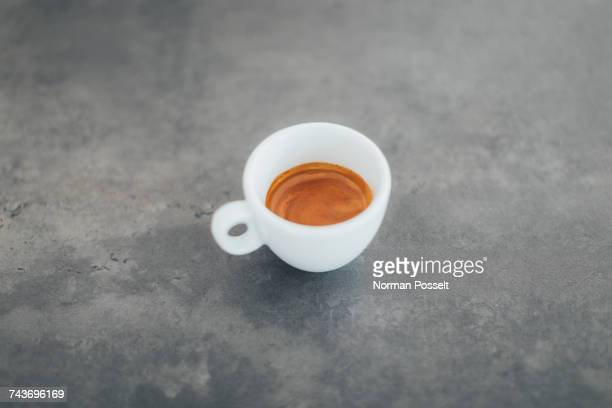 High angle view of fresh espresso on table at cafe