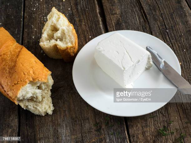High Angle View Of Fresh Feta Cheese And Bread Wooden Table
