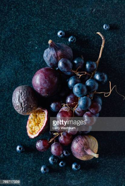 high angle view of fresh fruits on granite - maroon stock pictures, royalty-free photos & images