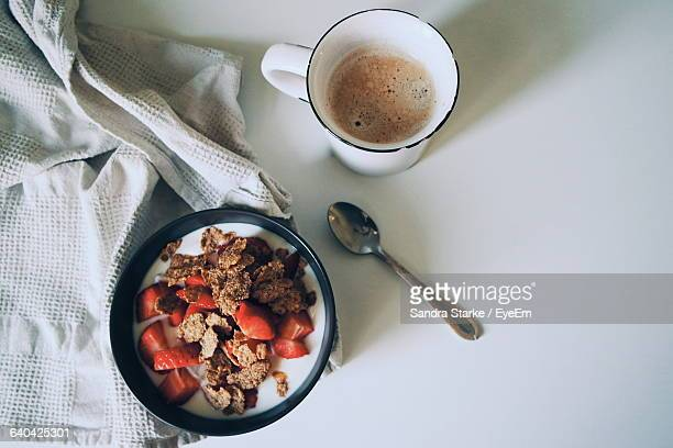 High Angle View Of Fresh Healthy Breakfast Served With Coffee On White Table
