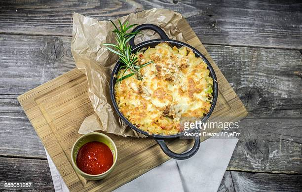 High Angle View Of Fresh Macaroni And Cheese In Container On Table