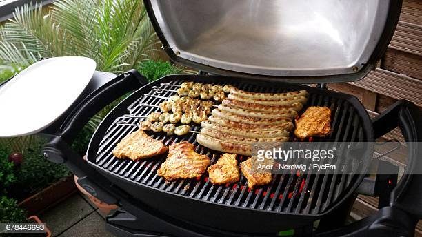 High Angle View Of Fresh Meat On Barbecue Grill In Back Yard