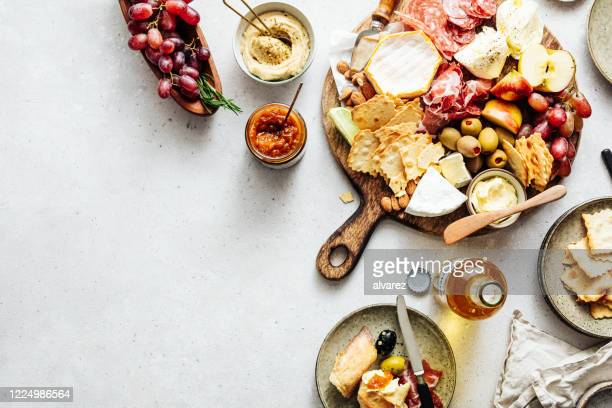 high angle view of fresh mediterranean tapas platter - antipasto stock pictures, royalty-free photos & images