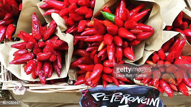 High Angle View Of Fresh Red Chili Peppers At Market Stall