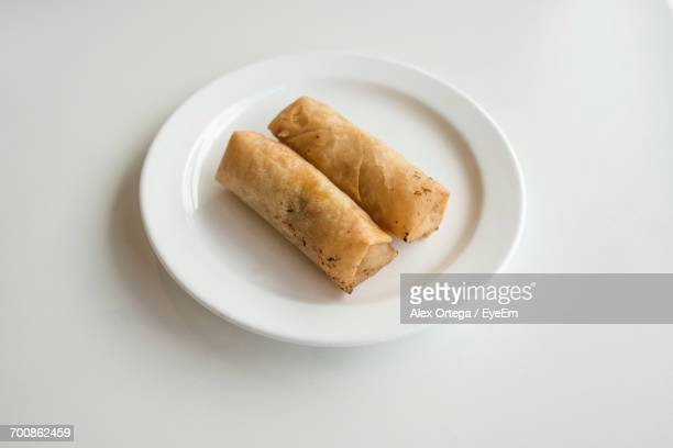 High Angle View Of Fresh Spring Rolls Served In Plate On White Background