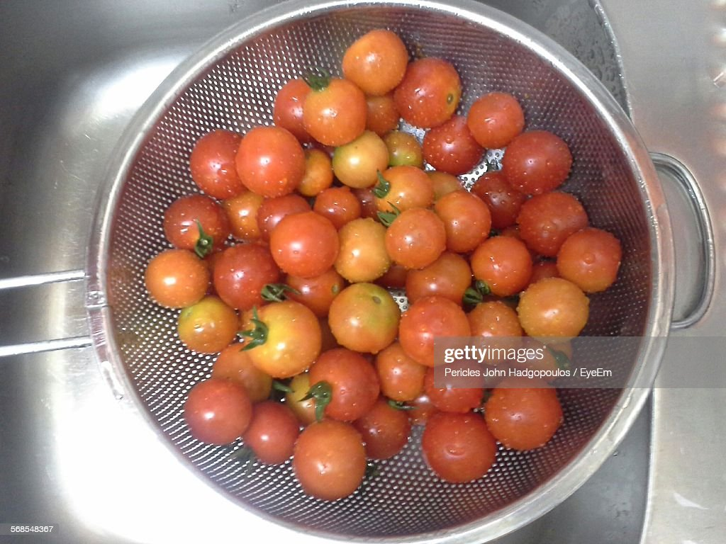 High Angle View Of Fresh Tomatoes In Container : Stock Photo