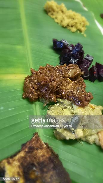High Angle View Of Fresh Vegetable Curries Served On Banana Leaf