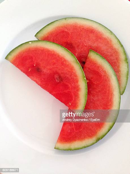 High Angle View Of Fresh Watermelon Slices In Plate On White Background