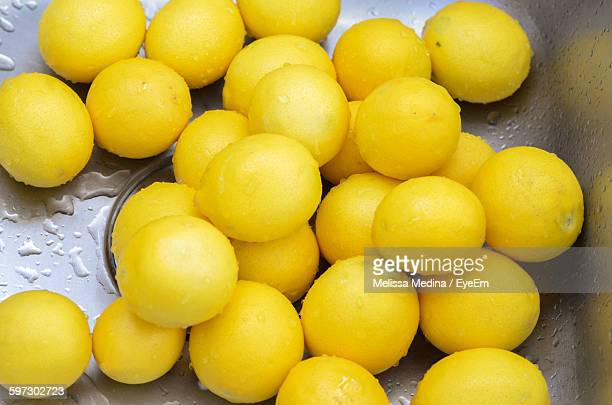 High Angle View Of Fresh Wet Lemons In Kitchen Sink