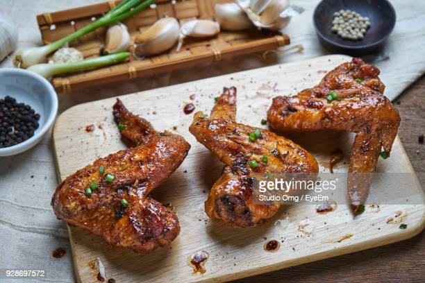 high angle view of fried chicken wings on cutting board over able - fried chicken stock photos and pictures