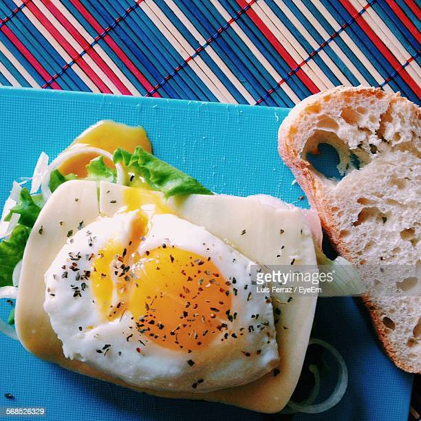High Angle View Of Fried Egg And Toast Served In Plate