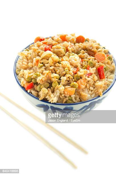 High Angle View Of Fried Rice Over White Background