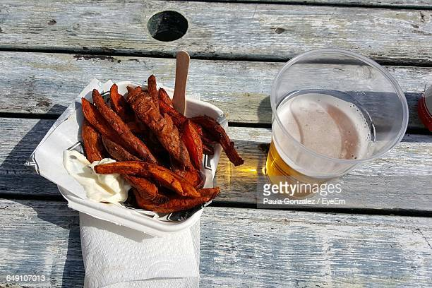 High Angle View Of Fried Sweet Potatoes In Beer On Table