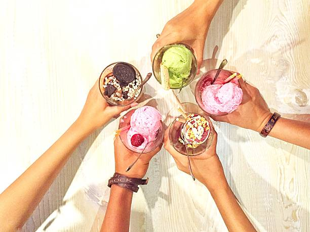 High Angle View Of Friends Cheering Ice Creams Wall Art