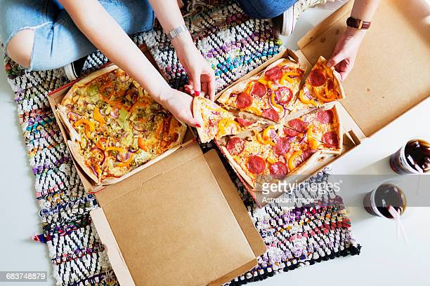high angle view of friends eating pizza with cola in new home - take away food stock pictures, royalty-free photos & images