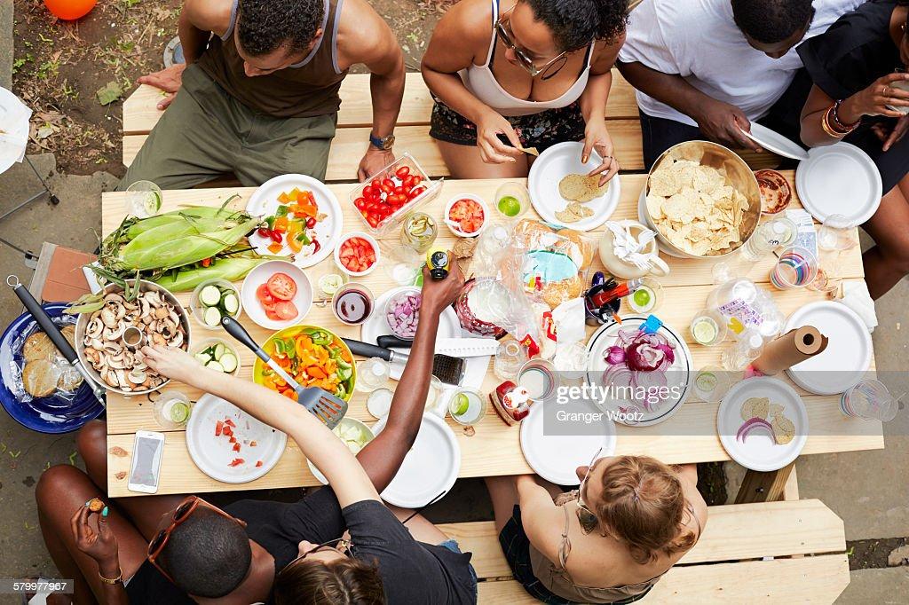 High angle view of friends enjoying backyard barbecue : Stock Photo
