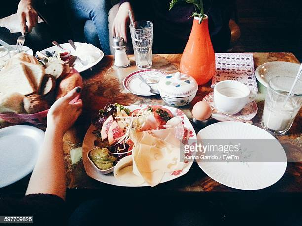 high angle view of friends enjoying brunch at restaurant - the brunch stock pictures, royalty-free photos & images