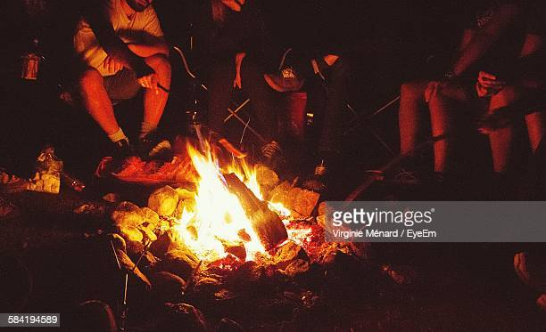 High Angle View Of Friends Enjoying By Campfire