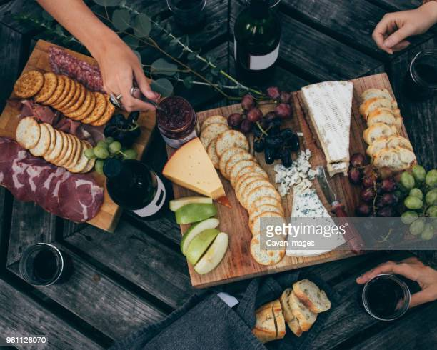 high angle view of friends having breakfast - spread food stock pictures, royalty-free photos & images