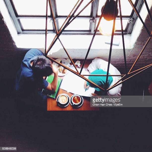 High Angle View Of Friends In Restaurant