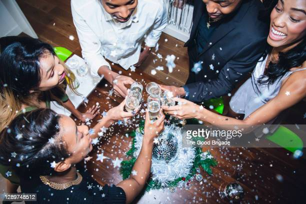 high angle view of friends toasting champagne at party - celebratory toast stock pictures, royalty-free photos & images