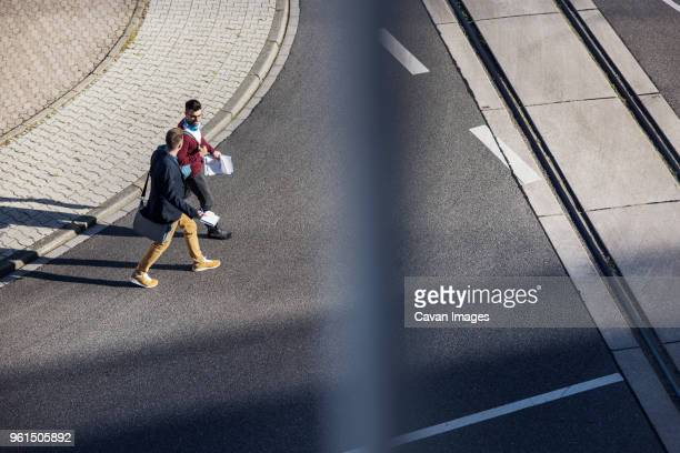 High angle view of friends walking on road