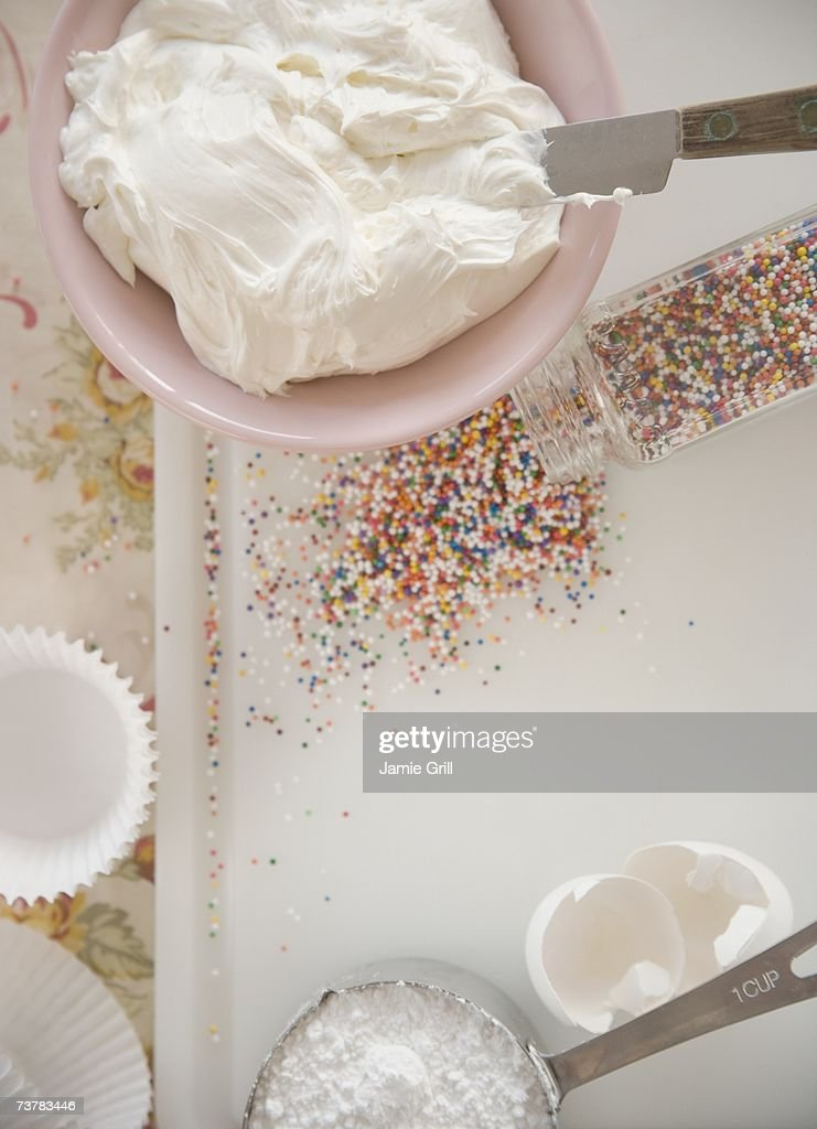 High angle view of frosting and sprinkles : Stock Photo