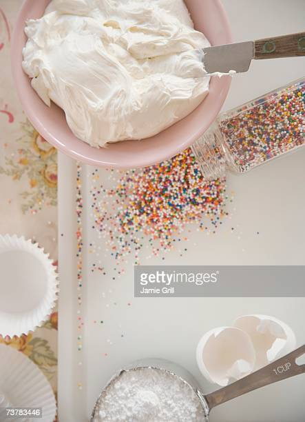 high angle view of frosting and sprinkles - icing stock pictures, royalty-free photos & images