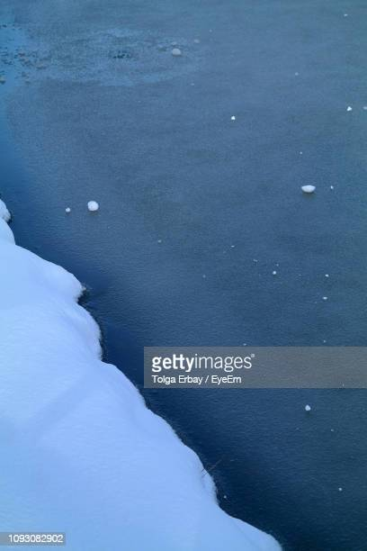 high angle view of frozen sea - tolga erbay stock photos and pictures