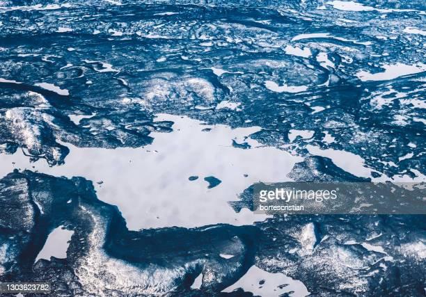 high angle view of frozen sea - bortes stockfoto's en -beelden