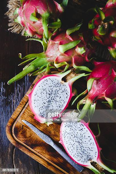 high angle view of fruit on table - dragon fruit stock pictures, royalty-free photos & images