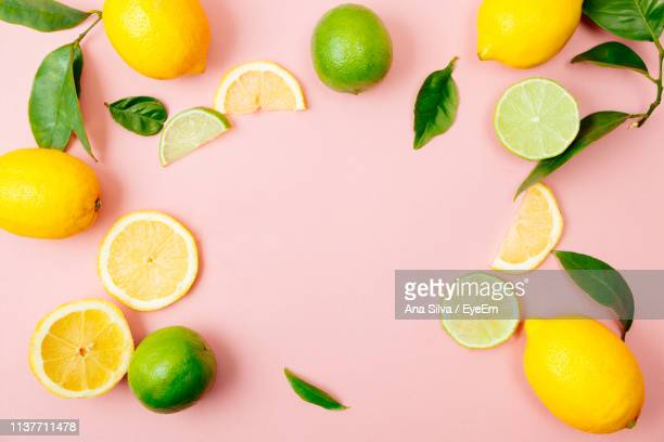 High Angle View Of Fruits Against Pink Background
