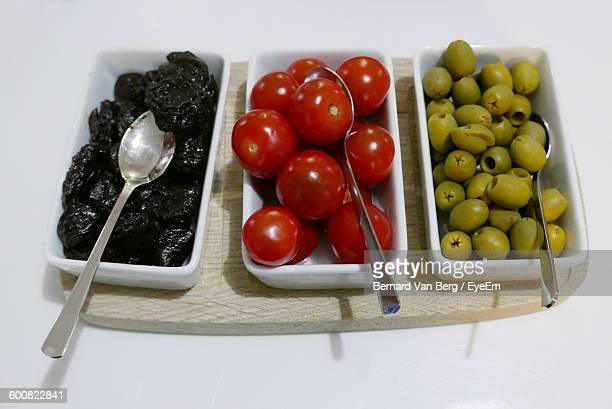 High Angle View Of Fruits And Vegetables Against White Background