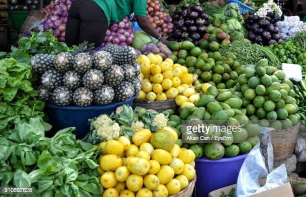 high angle view of fruits and vegetables for sale at market stall - ghana stock pictures, royalty-free photos & images