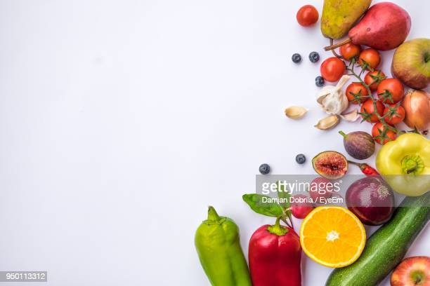 high angle view of fruits and vegetables on white background - legume - fotografias e filmes do acervo