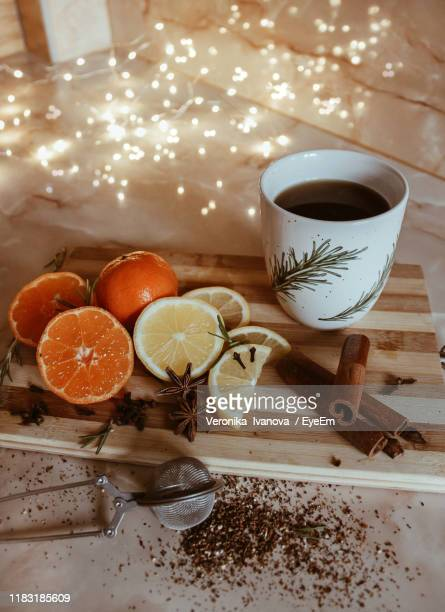 high angle view of fruits by coffee cup on table - hygge stock-fotos und bilder