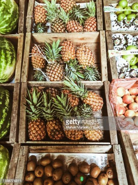 high angle view of fruits for sale at market stall - abundance stock pictures, royalty-free photos & images