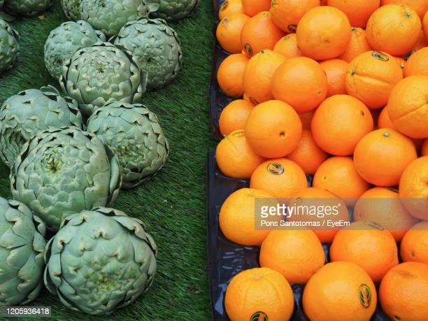 high angle view of fruits for sale at market stall - sale la rochelle stock pictures, royalty-free photos & images