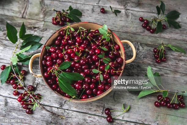 high angle view of fruits in bowl on table - サワーチェリー ストックフォトと画像