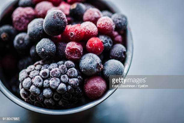 high angle view of fruits in bowl on table - eingefroren stock-fotos und bilder
