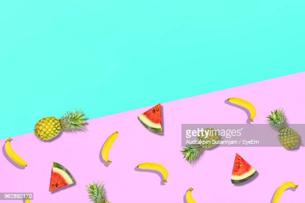 High Angle View Of Fruits Over Colored Background