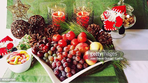 High Angle View Of Fruits Served On Table During Christmas
